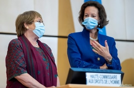 U.N. High Commissioner for Human Rights Michelle Bachelet speaks with the President of the Human Rights Council Elisabeth Tichy-Fisslberger during the 45th session of the Human Rights Council, at the European U.N. headquarters in Geneva, Sept. 14, 2020.