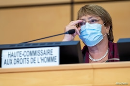 United Nations' High Commissioner for Human Rights Michelle Bachelet adjusts her glasses during the opening of 45th session of the Human Rights Council, at the European U.N. headquarters in Geneva, Switzerland, Sept. 14, 2020.