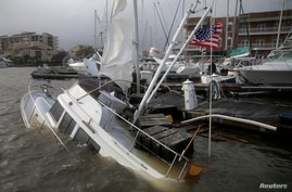 A boat is damaged by Hurricane Sally in Pensacola, Florida, Sept. 16, 2020.
