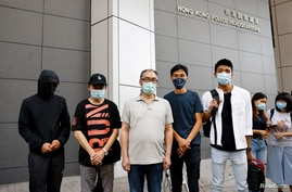 Pro-democracy activists Eddie Chu and Owen Chow with relatives of some of the 12 Hong Kong activists detained at sea, as they reportedly sailed to Taiwan for political asylum, report to the police to seek help in Hong Kong, Sept. 20, 2020.