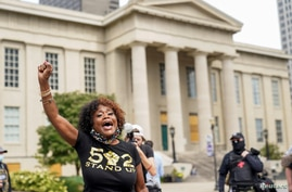 People react after a decision in the criminal case against police officers involved in the death of Breonna Taylor.