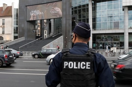 A French police stands near the Opera Bastille where a suspect in a stabbing attack near the former offices of the magazine…