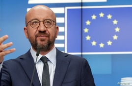FILE - European Council President Charles Michel attends a news conference following a virtual summit with European Commission President Ursula von der Leyen and European leaders in Brussels, August 19, 2020.