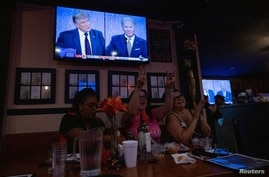 Women for Trump cheer for the president at a 'Debate Watch Party' during the Presidential debate