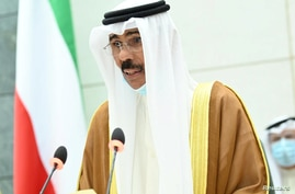 Kuwait's new Emir Nawaf al-Ahmad al-Sabah takes the oath of office at the parliament, in Kuwait City, Kuwait September 30, 2020…