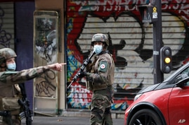 French soldiers patrol after four people have been wounded in a knife attack near the former offices of satirical newspaper