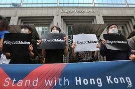 "Supporters of Hong Kong protesters stage a rally calling for a boycott of the Disney-produced film ""Mulan"" outside Walt Disney…"