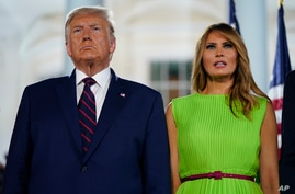 President Donald Trump and first lady Melania Trump stand on the South Lawn of the White House