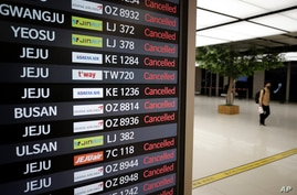 An electronic signboard shows canceled domestic flights at the Gimpo Airport in Seoul, South Korea, Wednesday, Sept. 2, 2020…