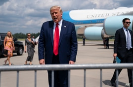 President Donald Trump talks to a crowd of supporters after arriving at Wilmington International Airport, Wednesday, Sept. 2,…