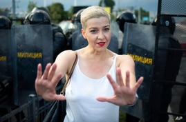 FILE - In this Sunday, Aug. 30, 2020 file photo, Maria Kolesnikova, one of Belarus' opposition leaders, gestures during a rally…