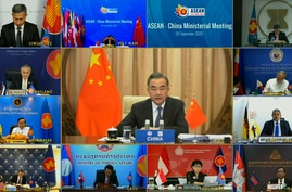 In this image taken from video provided by VTV, Chinese Foreign Minister Wang Yi speaks during an online meeting with ASEAN foreign ministers, Sept. 9, 2020.
