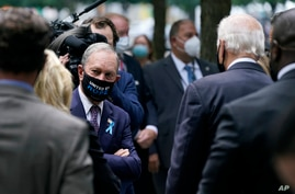Former New York Mayor Michael Bloomberg, left, visits with Democratic presidential candidate and former Vice President Joe Biden at the National Sept. 11 Memorial in New York, Sept. 11, 2020.
