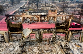 Facades stand among rubble at the Parkview Townhomes in Talent, Oregon, Sept. 16, 2020, following the Almeda Fire.