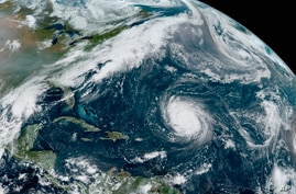 This GOES-16 GeoColor satellite image taken Friday, Sept. 18, 2020, at 12:20 p.m. EDT., and provided by NOAA, shows Hurricane…