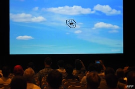 FILE - An Amazon delivery drone is displayed on a screen during a video presentation at an Amazon conference on robotics and artificial intelligence, in Las Vegas, Nevada, June 5, 2019.