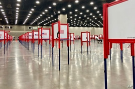 FILE - Voting stations are set up for a primary election at the Kentucky Exposition Center, in Louisville, Kentucky, June 22, 2020.
