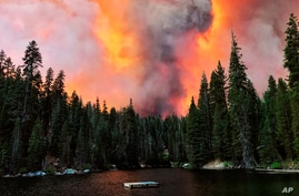 Smoke from the Creek Fire billows beyond a ridge as seen from Huntington Lake, California, Sept. 5, 2020.