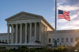 An American flag flies at half-staff at the Supreme Court on the morning after the death of Justice Ruth Bader Ginsburg, in Washington, Sept. 19, 2020.