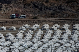 A general view of the temporary camp for refugees and migrants near Mytilene town, on the northeastern island of Lesbos, Greece, Sept. 13, 2020.