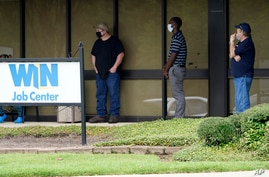 FILE - Job seekers line up outside the Mississippi Department of Employment Security WIN Job Center in Pearl, Mississippi, Aug. 31, 2020.