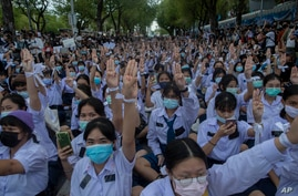High school students flash the three-fingered salute, symbol of resistance, during a protest rally in Bangkok, Thailand, Sept. 5, 2020.
