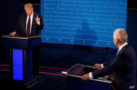 President Donald Trump makes a point as Democratic presidential candidate former Vice President Joe Biden looks on during the first presidential debate, Sept. 29, 2020, at Case Western University and Cleveland Clinic, in Cleveland, Ohio.