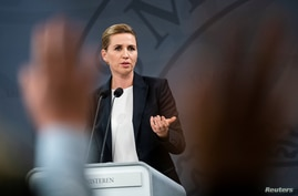 Denmark's Prime Minister Mette Frederiksen speaks at a COVID-19 news conference, in Copenhagen, Denmark, Sept. 18, 2020.