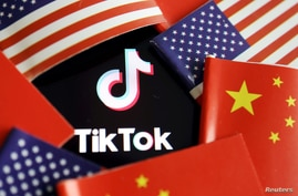 FILE - U.S. and Chinese flags surround a TikTok logo in this illustration photo taken July 16, 2020.