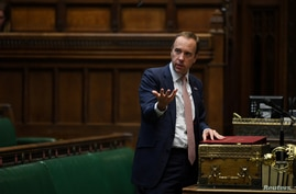 Britain's Health Secretary Matt Hancock makes a statement on the COVID-19 in the House of Commons, in London, Sept. 21, 2020.