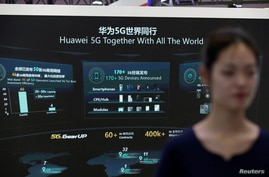 FILE - Information on Huawei's 5G equipment is seen on a screen at the World 5G Exhibition in Beijing, China, Nov. 22, 2019.