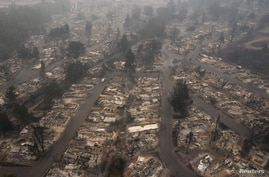 The gutted Medford Estates neighborhood is seen in the aftermath of the Almeda Fire in Medford, Oregon, Sept. 11, 2020.