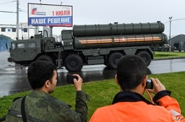 Russian S-400 Triumf surface-to-air missile launchers roll ahead of a second night of rehearsals for the WWII Victory Parade in…