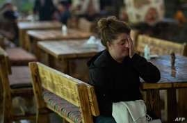 A woman, who fled the breakaway Nagorno-Karabakh region for Armenian territory, reacts in the border town of Goris on October 5…