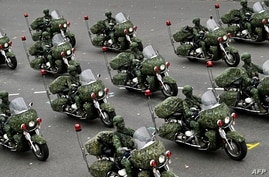 Taiwan's military police perform during the National Day in front of the Presidential Office in Taipei on October 10, 2020. …
