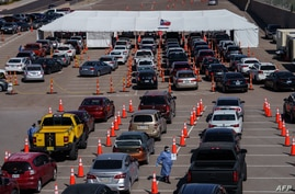 Cars line up for Covid-19 tests at the University of Texas El Paso on October 23, 2020 in El Paso, Texas. - The city has seen a…