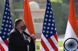 US Secretary of State Mike Pompeo leaves after addressing a joint press briefing in the lawns of Hyderabad House in New Delhi…