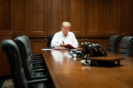 President Donald Trump works in his conference room at Walter Reed National Military Medical Center in Bethesda, Maryland, Oct. 3, 2020.