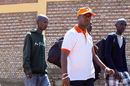 Rwandan singer Kizito Mihigo is escorted after his release from prison, in Kigali, Rwanda September 15, 2018. Picture taken…