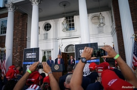FILE - U.S. President Donald Trump delivers remarks at Trump National Golf Club in Bedminster, NJ