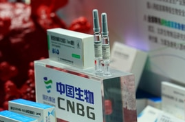 A booth displaying a coronavirus vaccine candidate from China National Biotech Group (CNBG) is seen at the 2020 China…