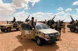 Troops loyal to Libya's internationally recognized government patrol the area in Zamzam, near Abu Qareen, Sept. 15, 2020.
