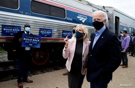 U.S. Democratic presidential candidate and former Vice President Joe Biden and his wife Jill greet supporters.