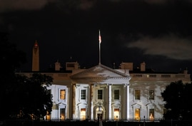 The White House is lit before dawn after U.S. President Donald Trump announced that he and U.S. first lady Melania Trump have…