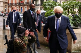 British Prime Minister Boris Johnson is seen outside the BBC headquarters, as the spread of the coronavirus disease (COVID-19)…