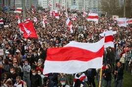 People attend an opposition rally to reject the presidential election results in Minsk, Belarus, Oct. 4, 2020.