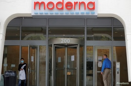 FILE PHOTO: A sign marks the headquarters of Moderna Therapeutics, which is developing a vaccine against the coronavirus…