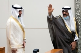 Kuwait's newly appointed crown prince Sheikh Meshal al-Ahmad Al-Jaber al-Sabah waves before he is sworn in, as speaker of the…