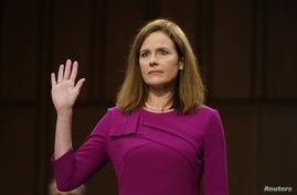 U.S. Supreme Court nominee Amy Coney Barrett is sworn in during her confirmation hearing before the Senate Judiciary Committee.