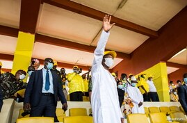Guinea's outgoing president and presidential candidate Alpha Conde, leader of Rally for the People of Guinea (RPG) waves.